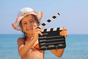 Girl Holding Clapboard
