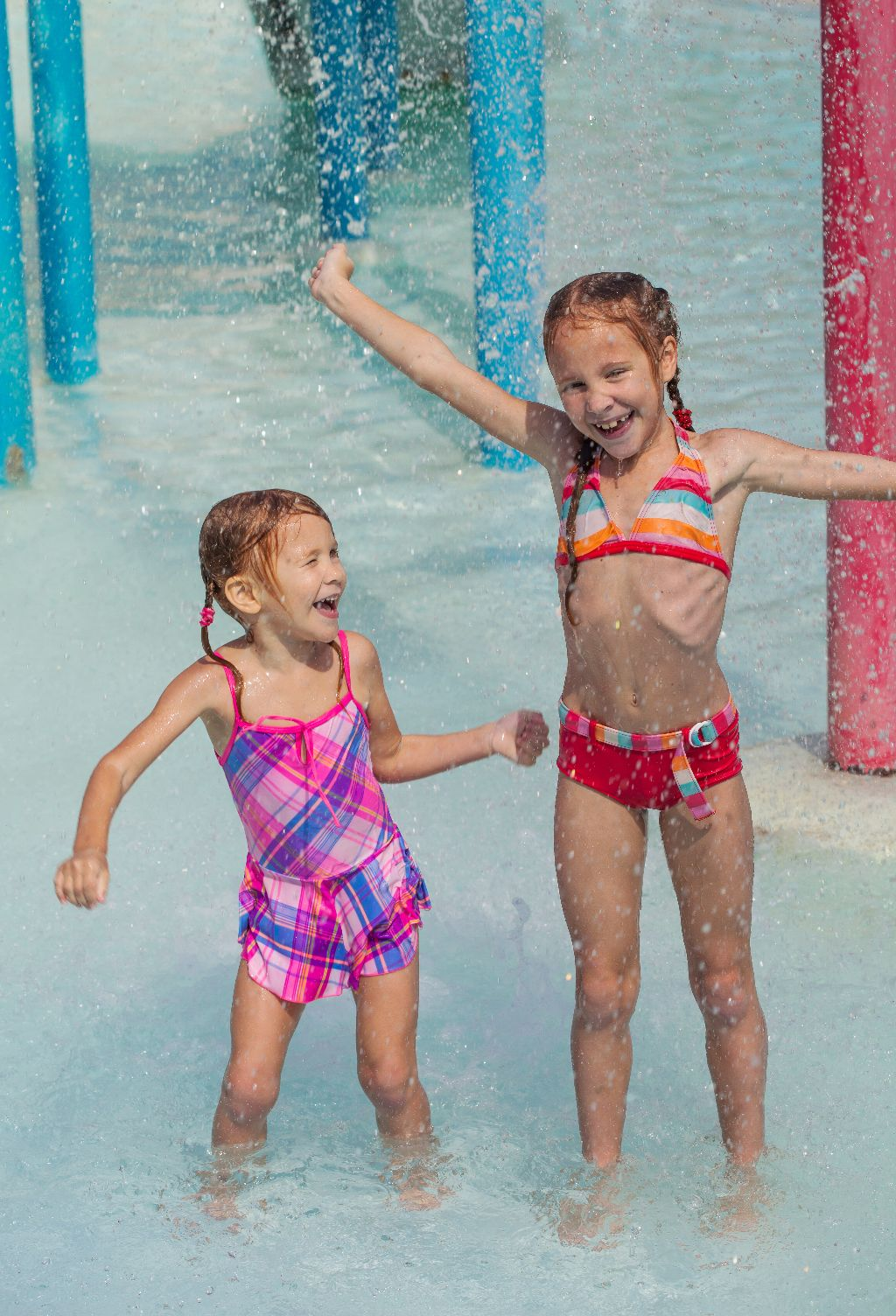 Two little girls playing in waterpark
