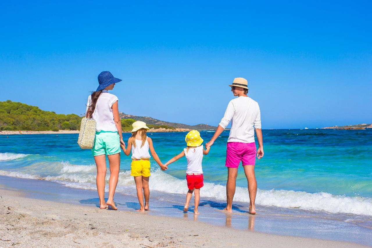 Happy family of four during beach