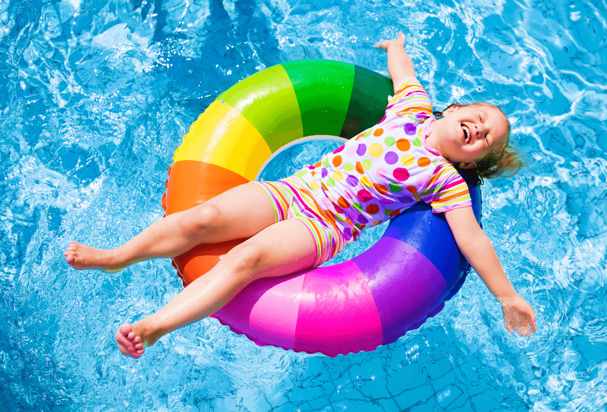 Happy child relaxing on pool inflatable