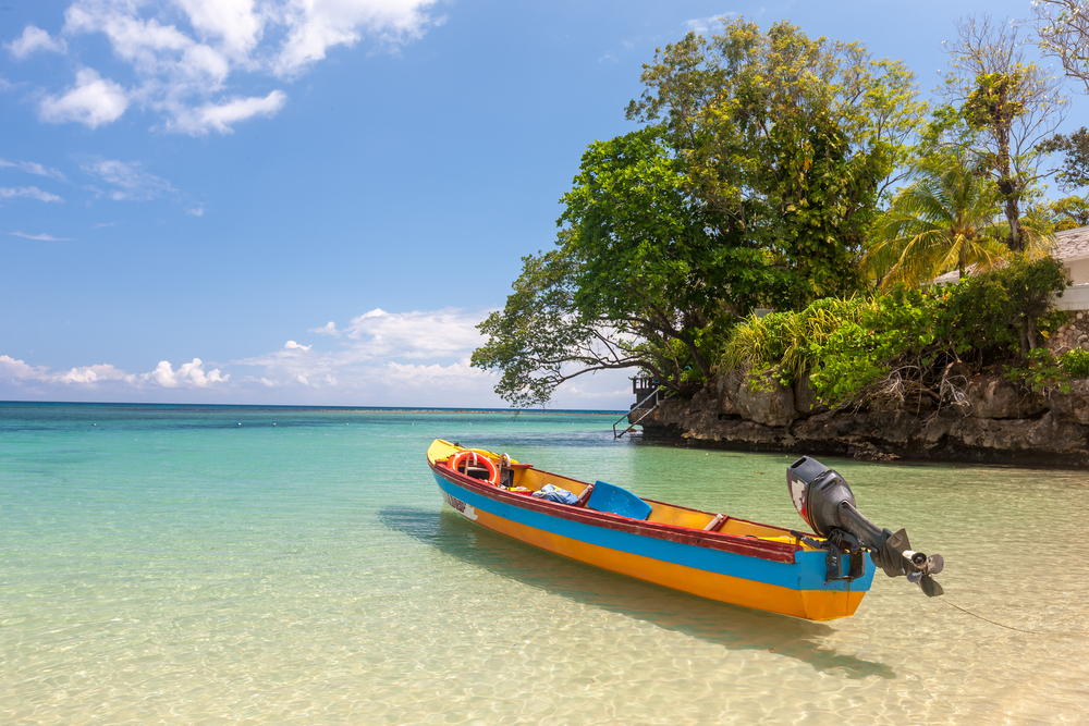 Fish boat on the paradise beach of Jamaica