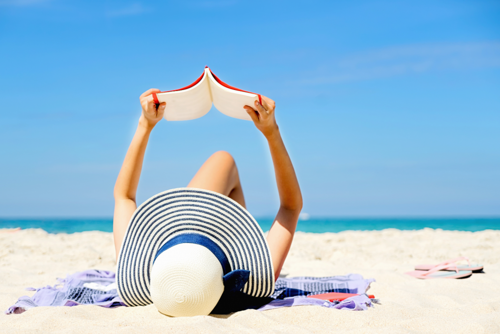 Lady reading on the beach