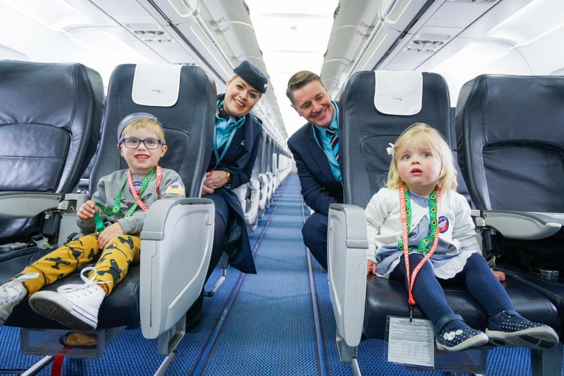 TUI Customers wearing sunflower lanyards on flight