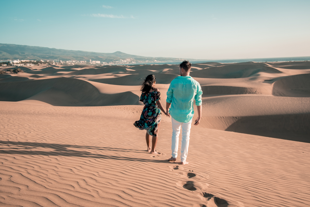 couple walking at the beach of Maspalomas Gran Canaria Spain